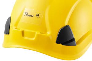 Transparent sticker displaying user name on VERTEX helmet.